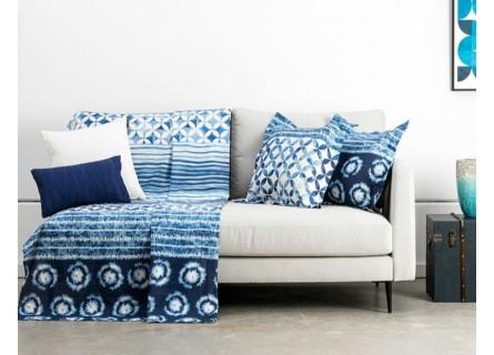 Cubre sofá en color azul para decorar y proteger tu sofá